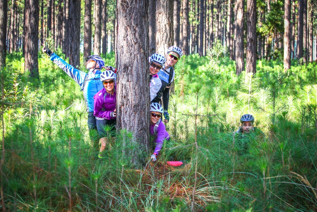 A group of riders get silly in the forest. Photo by Oakpics.com.
